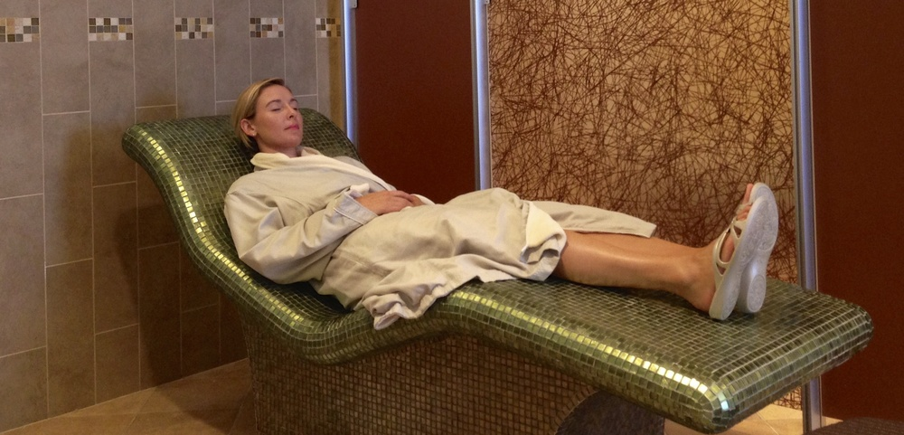 Lounging atop a heated chaise at Senses - A Disney Spa