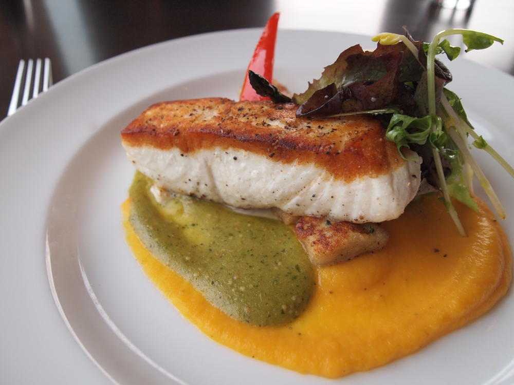 Seared Ocean Wise halibut in a butternut squash puree with ricotta gnocchi