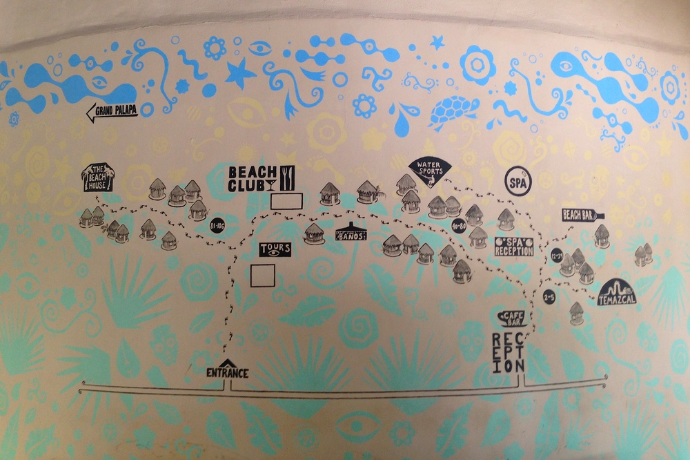 A map of the property painted on the wall of the lobby