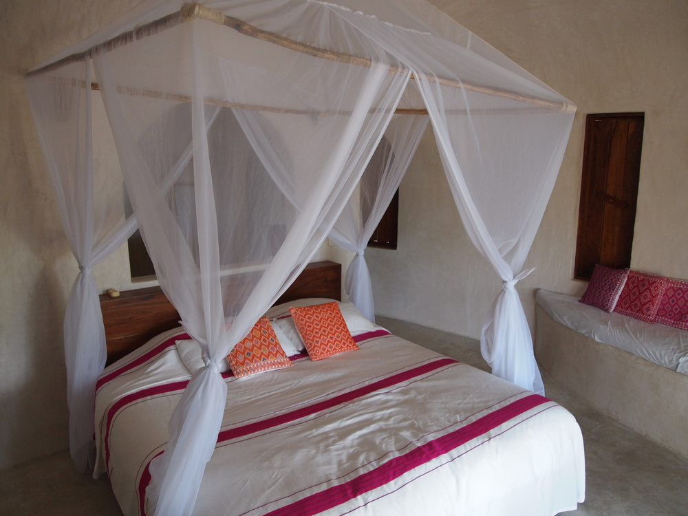 Mexico. The simple and perfect bedspreads, designed by the hotel owner at Papaya Playa Project.