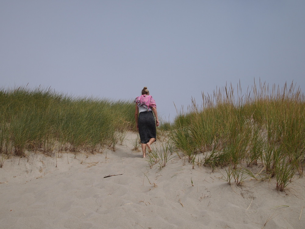 Oregon. Walking along the dunes at Pacific City beach.