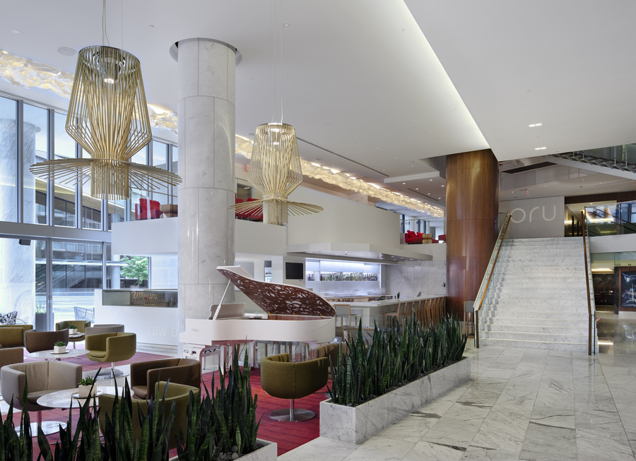 Fairmont Pacific Rim's lobby, the gold standard for gathering places in Canada with servers wandering around in red carpet-ready frocks, all-day music played on the custom Fazioli piano handcrafted in Italy, and so much marble it's like you're in a quarry.