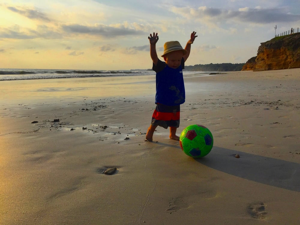 Baby Styler learning how to walk and play soccer {at the same time} on the beach in Punta Mita.