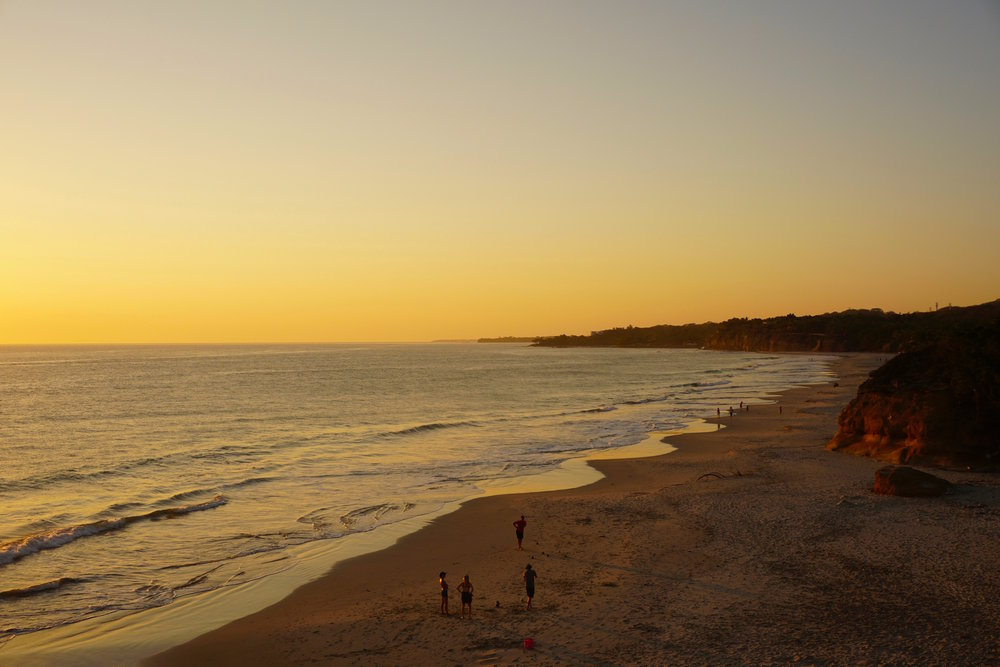 Golden hour view of Playa Las Destiladeras. The amount of people you see in this shot was part of this beach's perfection: Busy enough so you're not worried about safety, yet deserted enough that you have space and serenity.