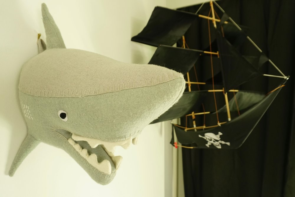 """Larry"" the friendly shark, and a tall-ship kite we purchased in Bali, hanging above Blue Styler's bed"