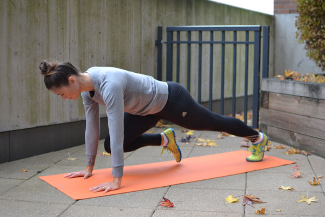 9. Plank with knee tucks   *Engage every muscle from head to toe as though you were a rigid board. Alternate bringing your right knee to your right elbow and your left knee to your left elbow.