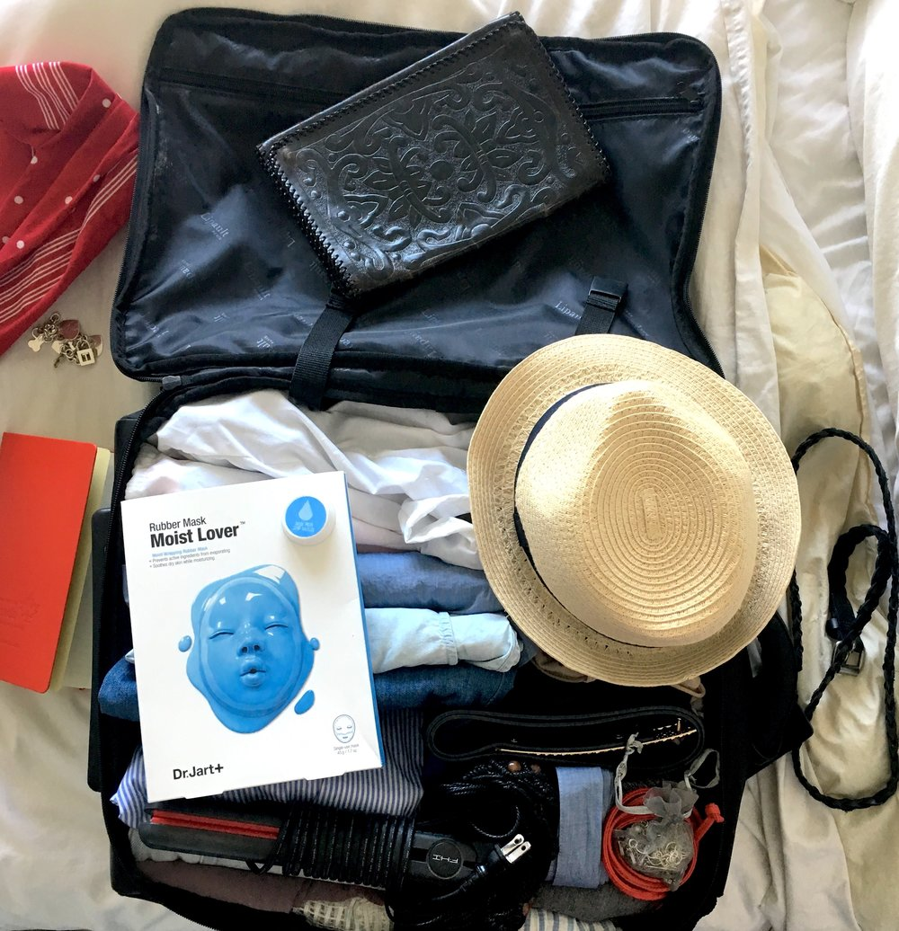 "What I packed into my New York carry-on: - Running shoes and workout gear - Going out/chic sightseeing shoes - Skirt - 5 dresses - Jean shorts - 4 tops - Other: toiletries, jewelry, belts, scarves, bathing suit, ""crushable"" hat, camera, hair straightener, clutch purse"