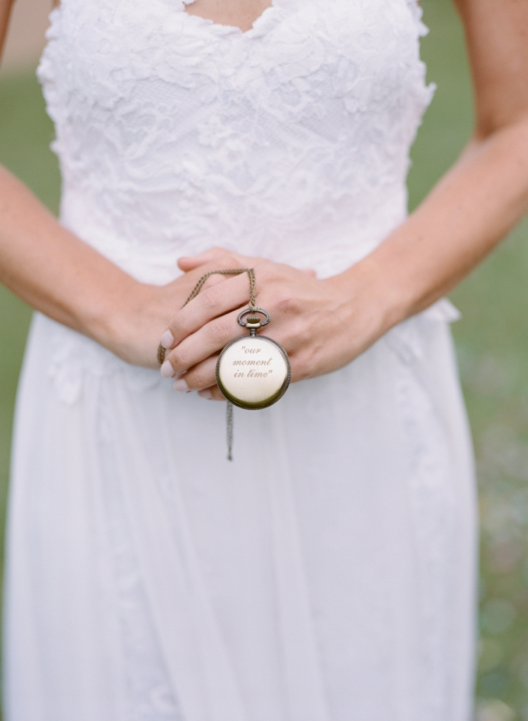 A shot taken from  Lauren and Nathan's  wedding. Nathan had this watch on him when he proposed to Lauren, when she said yes he took out the watch and broke it. Freezing the exact time forever. A beautiful and  personal  touch.