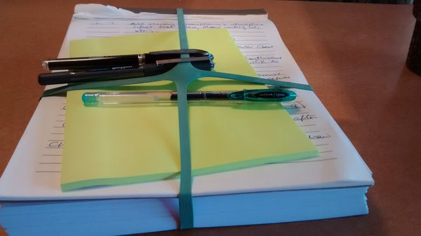A work-in-progress: my first draft manuscript, my list of revision notes, and pens and Post-Its to put it all in order.