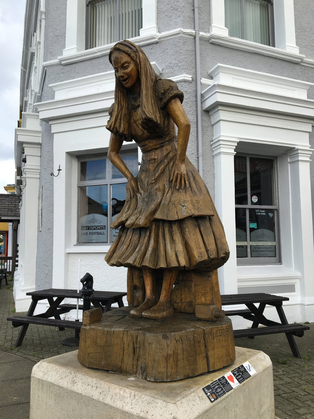 statue of Alice in Wonderland outside the Llandudno train station