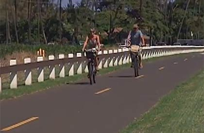 Family cycling on Maui in Paia.