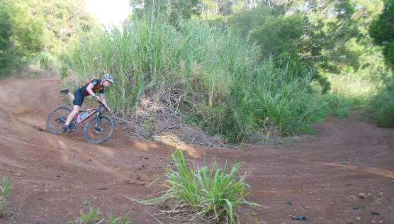 Riding a mountain bike trail in West Maui.