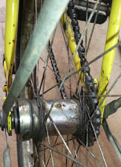 Vintage cruiser axle and chain after shipping the bicycle to Maui.