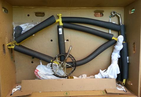 Foam tubing on bike frame before bicycle shipping to Maui.