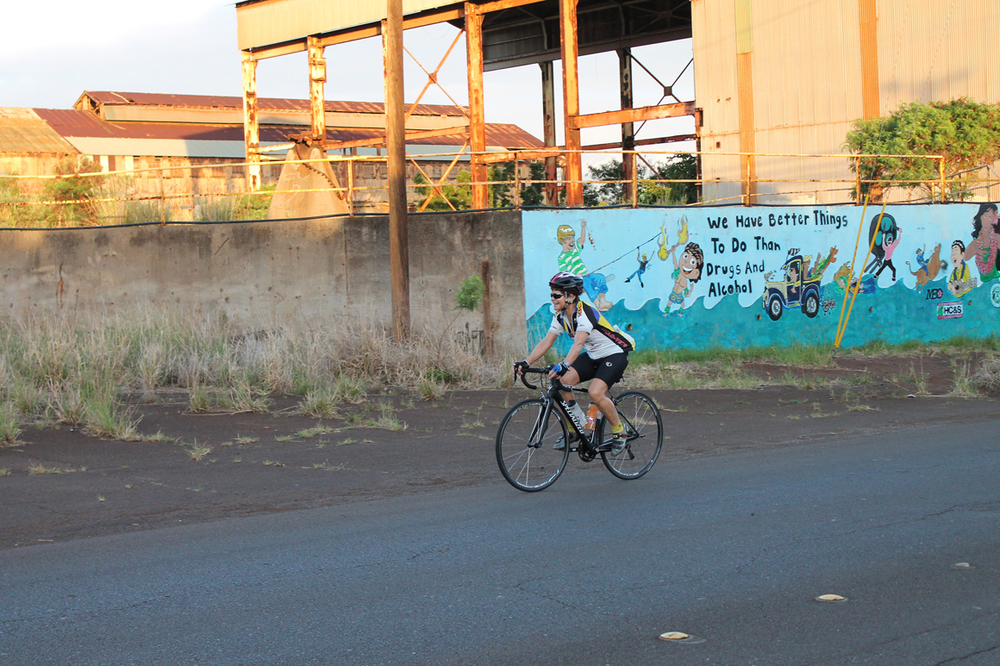 Ellen rides past the old sugar mill at Paia. Even here, the grade was about 4-5 percent.