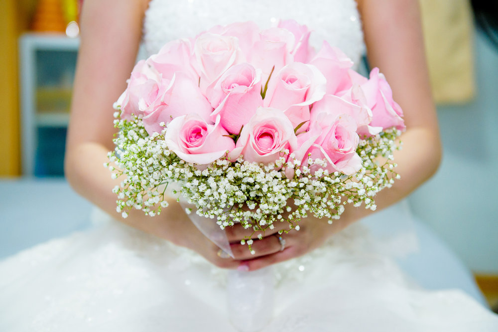 bride and hand flower