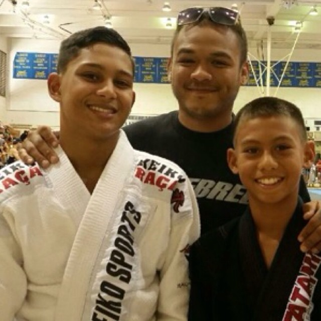 Coach Brandon with Jonah right before he won #Gold in Gi and Silver in NoGi after getting bumped up a weight class and rank at #hawaii 👑👑👑 @thefowlereffect #oahu #nsjjclub #bjj