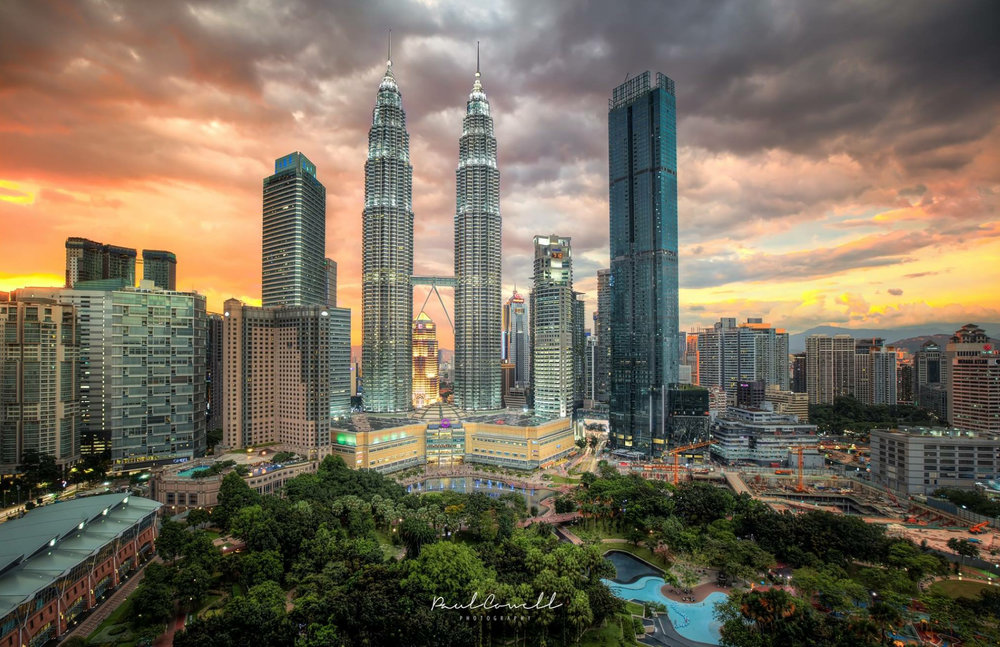 The twin towers lit underneath a Kuala Lumpur Sunset