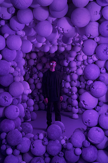 Daniel Arsham (American, born 1980)   Amethyst Sports Ball Cavern , 2016 Amethyst crystal, quartz, and hydrostone Courtesy of Galerie Perrotin/photo by Guillaume Ziccarelli [Daniel Arsham standing at center]