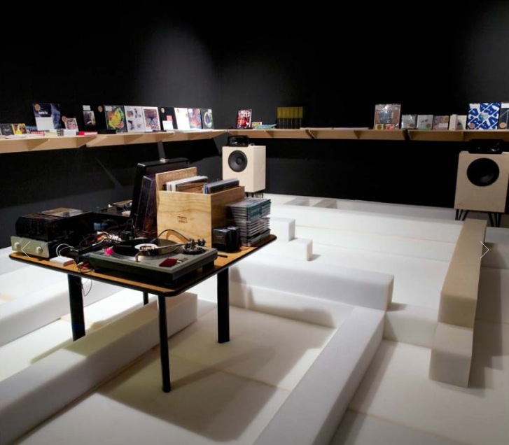 COURTNEY SMITH & IVÁN NAVARRO  The Music Room I, 2014  Polyethylene foam, vinyl record collection and editions of Hueso Records, sound installation and furniture!  Variable dimensions  Installation view at MoMA PS1, NY Art Book Fair and Printed Matter