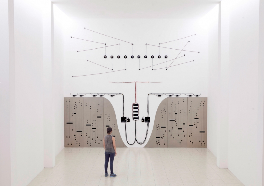 Naama Tsabar Propagation (Opus 3), 2015    Wood, speakers, amplifiers, mixers, wires, cables, piano strings, bone, cable holders, contact microphones, brass, sheet rock. 6.5 meters high x 6.8 meters wide.    MARTE- Contemporary, El Salvador Photo by Rodrigo Dada Courtesy of artist