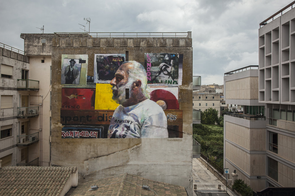 """Il Suonatore Gino"" - Completed mural by Sebas Velasco for the  Festi Wall in Ragusa , Italy.  Photos by  Vinny Cornelli"