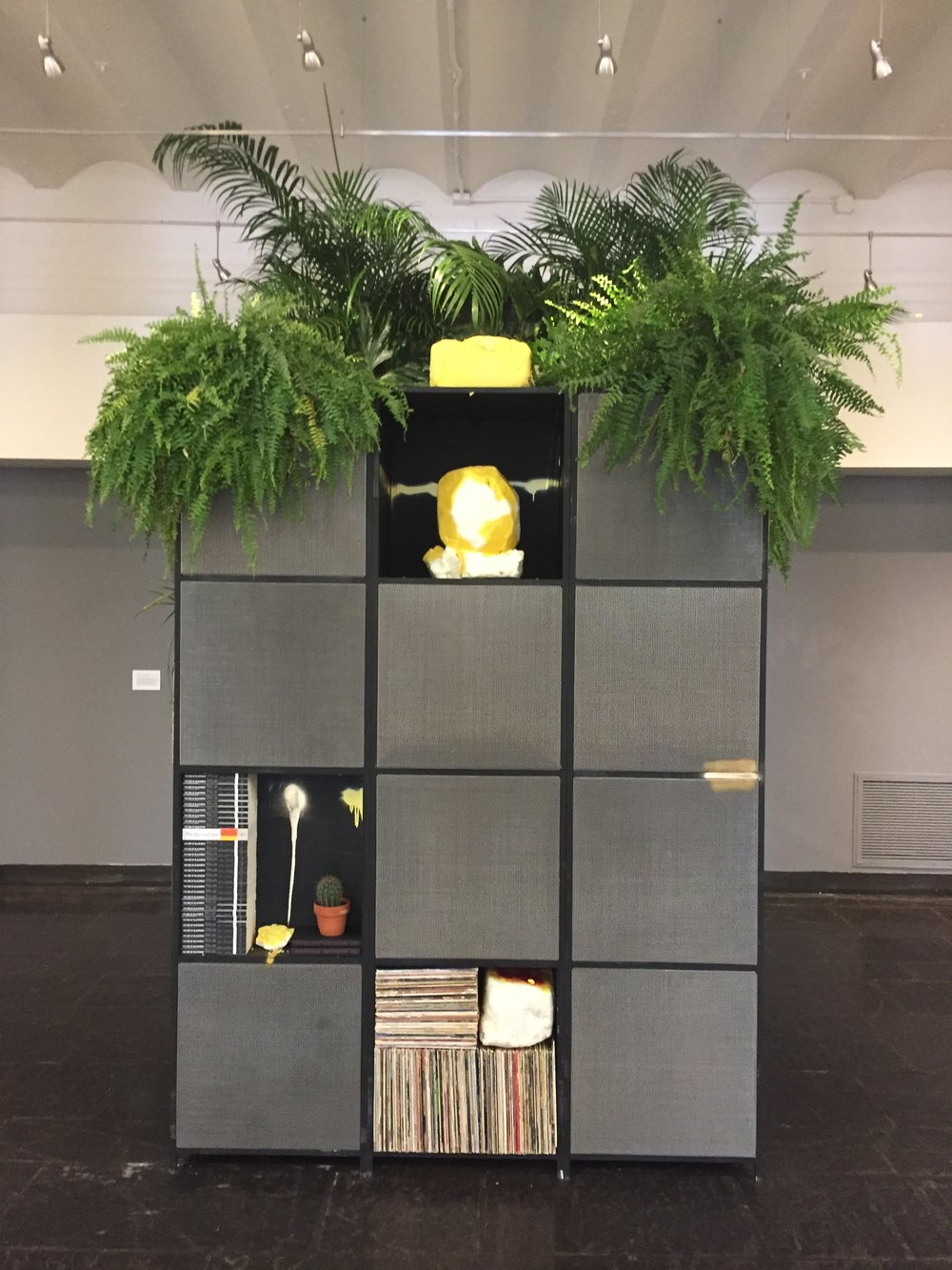 Fiend , 2017 Black Steel, microphone mesh, spray enamel, plant, books, vinyl, shea butter. Courtesy of the artist and Hauser & Wirth