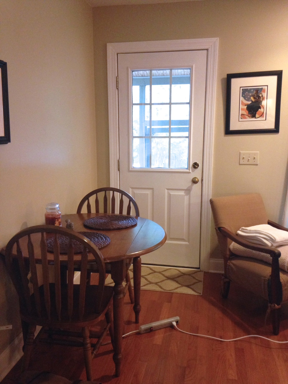 The dining room portion of our living space that often doubles as a desk for my design work.