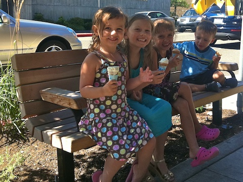 Summer = sitting on a bench eating ice cream.