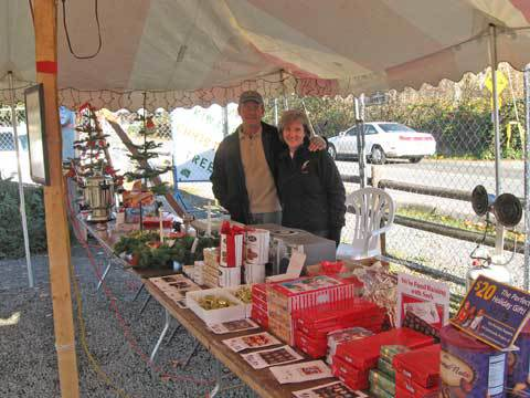 Kiwanis members Jay and Kim Henwood with a selection of the goodies for sale. 2011