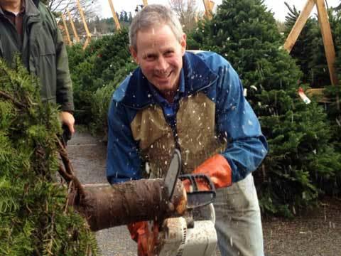 Mark Shinstrom hams it up for the camera at the Kiwanis Christmas Tree Lot at Juanita Beach Park. 2012