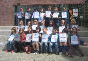 Sandburg Elementary kids holding their World Math Day certificates.