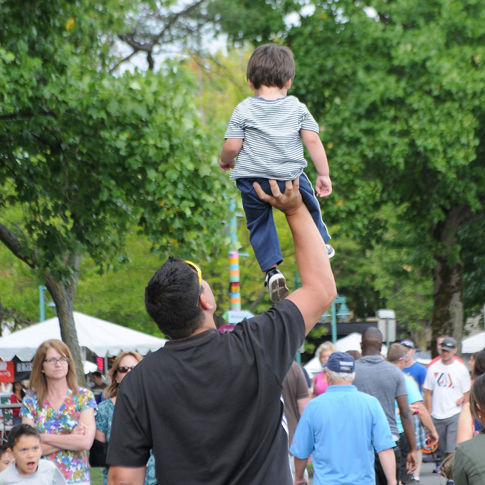 A dad and his son enjoying the day at Kirkland Summerfest