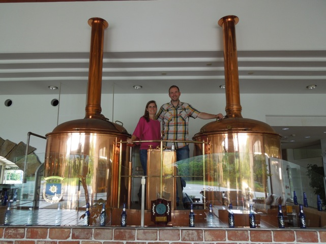 Michelle and Scott Holm standing with their Bavarian built 10 Hectolitre brewing system to be installed at Chainline Brewing Company.