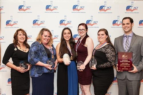 LWIT Culinary Arts team and regional winners, from left: Coach Janet Waters, Student Team Captain Tamera Harris, Alyssa Pereira, Ashley Haight, Andrea Martin, and Coach Matt DiMeo
