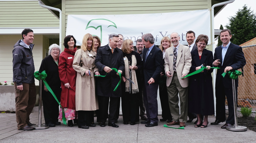 Elected officials join Friends of Youth officials to cut the ribbon for Friends of Youth's new transitional living homes for homeless youth. From left: State Senator Andy Hill, Kirkland City Councilmember Doreen Marchione, Bellevue City Councilmember Lynne Robinson, King County Councilmember Jane Hague, Kirkland Mayor Amy Walen, King County Executive Dow Constantine, Washington state First Lady Trudi Inslee, Medina Mayor Michael Luis, State Representative Roger Goodman, Friends of Youth President and CEO Terry Pottmeyer, State Representative Larry Springer, Friends of Youth Board Chair Nick Merriam, King County Councilmember Kathy Lambert and King County Councilmember Rod Dembowski.