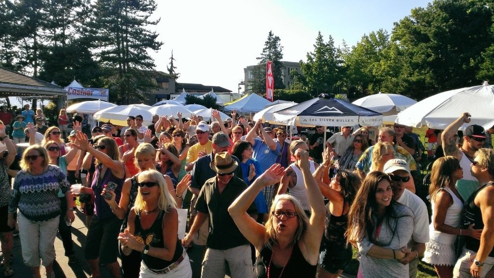 The crowd dancing to Cherry Cherry on Sunday at the Marina Park Stage during Kirkland Summerfest.