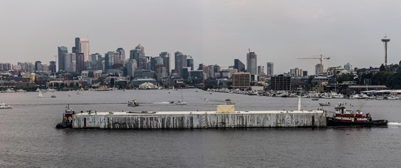 Longitudinal Pontoon C is guided across Lake Union en route to Lake Washington on Monday, Aug. 11. Photo taken from Gasworks Park, looking south.