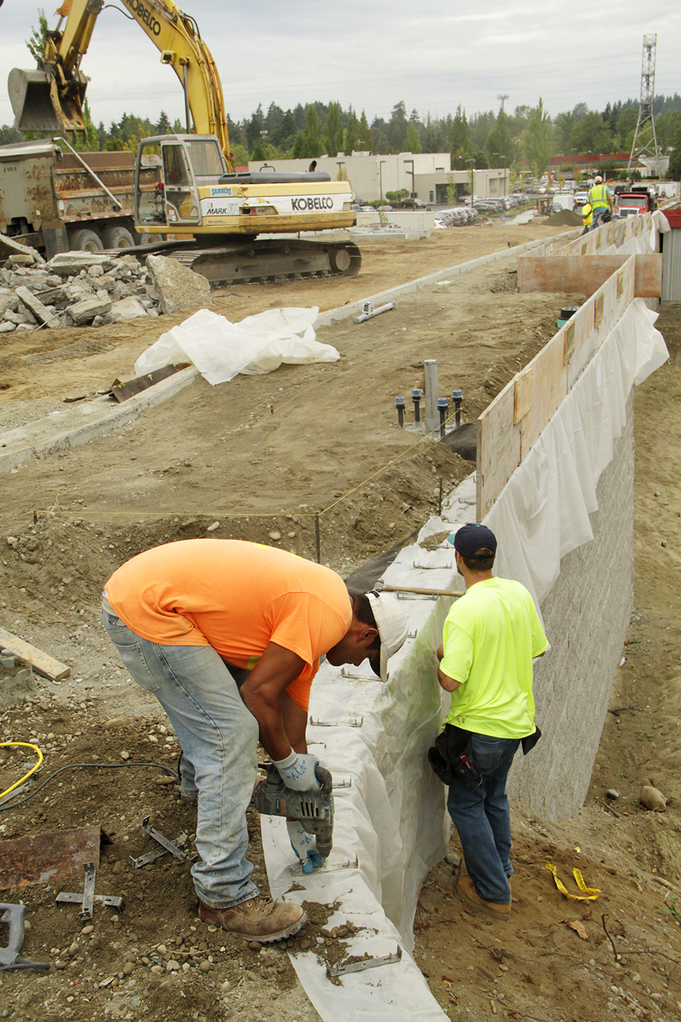 Wilson Concrete laborers Blake Hart and Jaime Santana prepare the sidewalk Sept. 23 for the hand railing.
