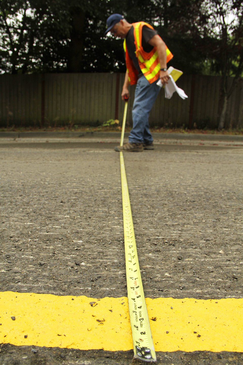 Inspector Jim Jennings measures 132nd Avenue Northeast, near Northeast 100th Street.