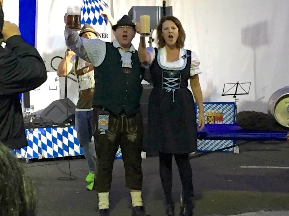 Creative Director Rob Butcher and Kirkland Mayor Amy Walen raising a glass to officially open Kirkland Oktoberfest 2014.