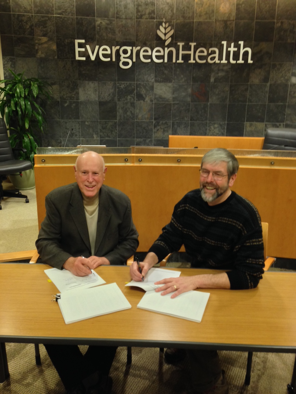 Chair of the EvergreenHealth Board of Commissioners, Al DeYoung (left), and Valley General Hospital Commissioner Tony Balk (right) signed the agreement.