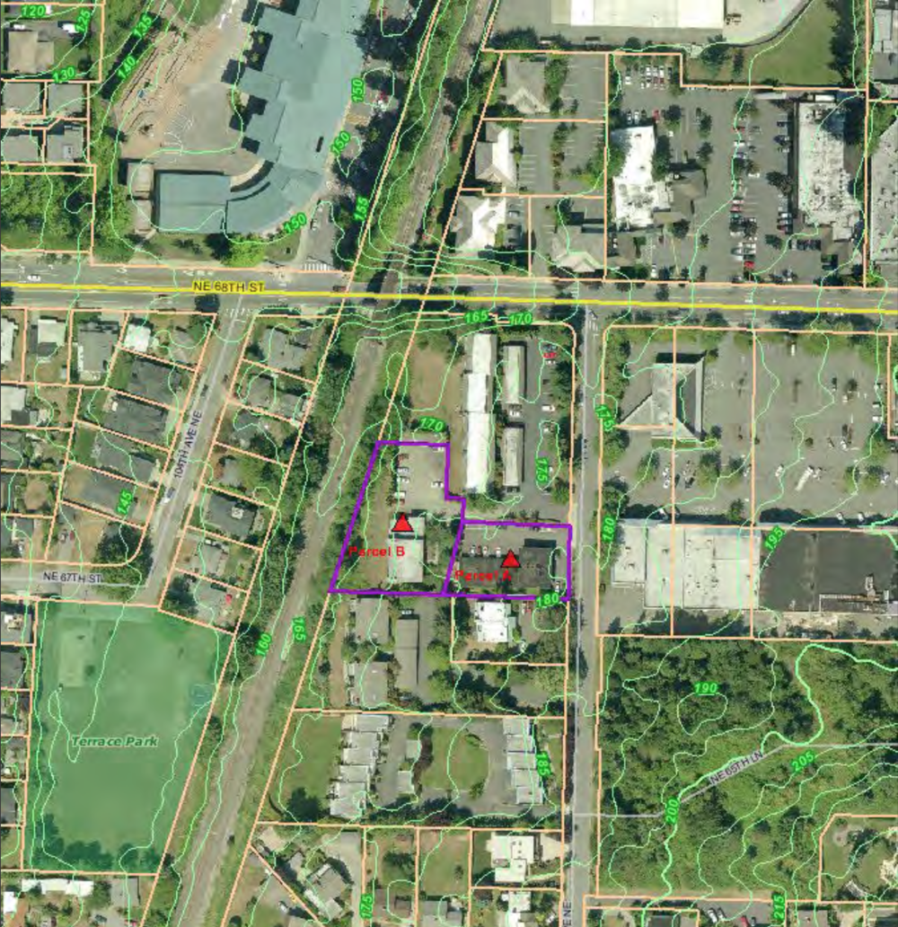 In this image, the subject properties (outlined in purple) are located between the Cross Kirkland Corridor and the Houghton Shopping Center.