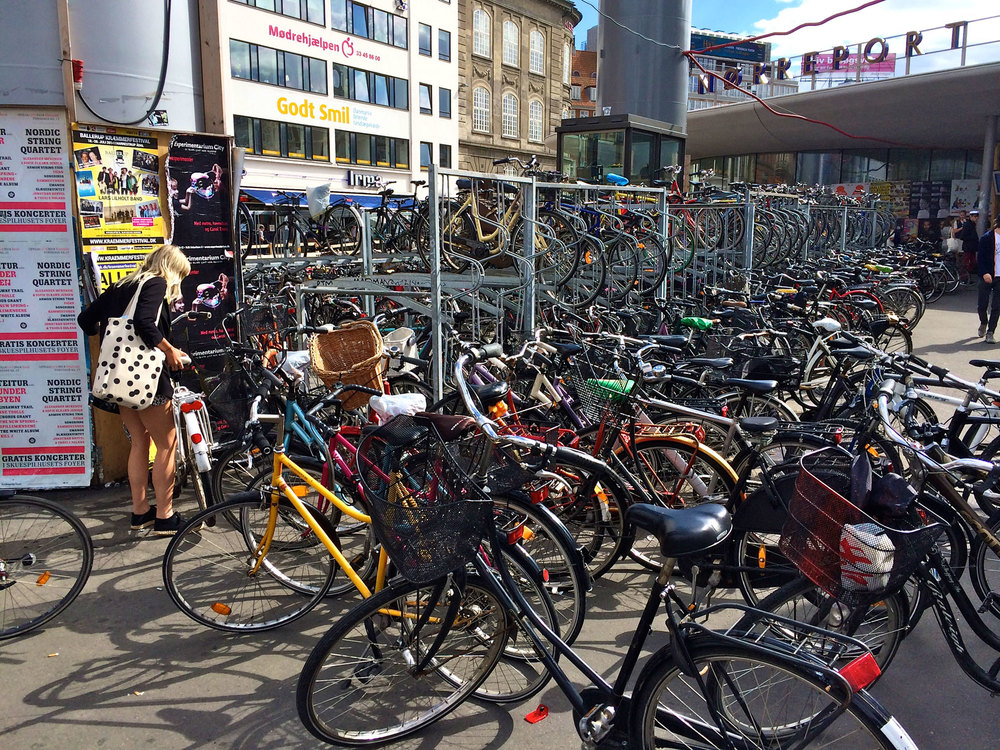 A bike parking lot stands in front of a metro station in Copenhagen