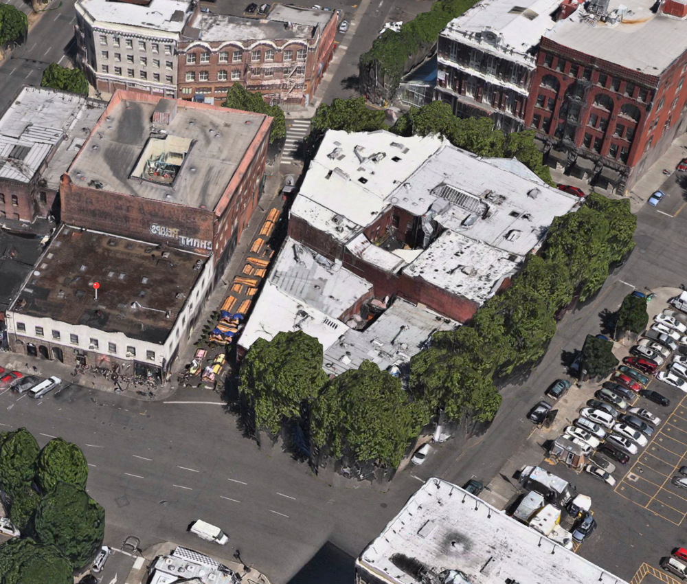 A view from Apple Maps shows the street lined with service areas including tables, benches and chairs. Click to views larger.