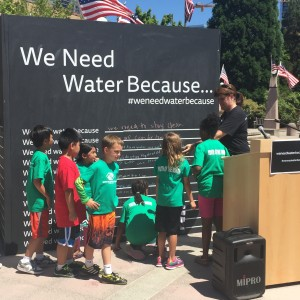 "Cutline: Cascade Water Alliance will have unique interactive wall that asks ""We Need Water Because…"" on display at Juanita Beach Park July 31 through August 4."