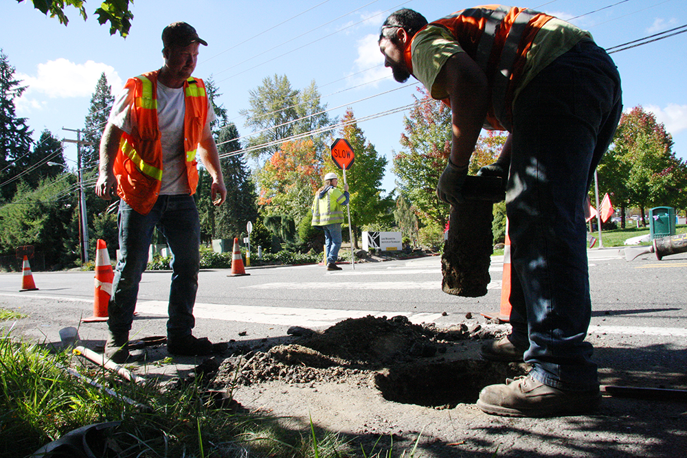 Watson Asphalt workers Tim Frohning and Corey Simmons remove a section of a stormwater utility pipe Sept. 22 on 132nd Avenue, near the entrance to Lake Washington Institute of Technology. Watson Asphalt began preparing 132nd Avenue Northeast, between Northeast 113th Street and Northeast 120th Street for repaving.