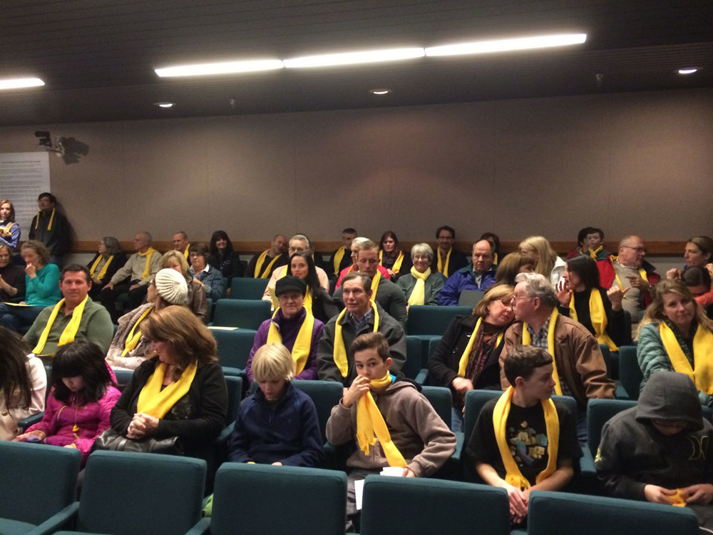 Citizens at council chambers sharing their views.