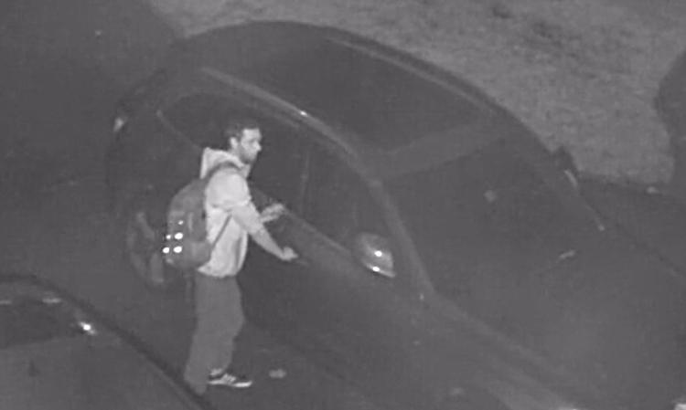 Car prowler in the Market Neighborhood caught on video, December 2014.