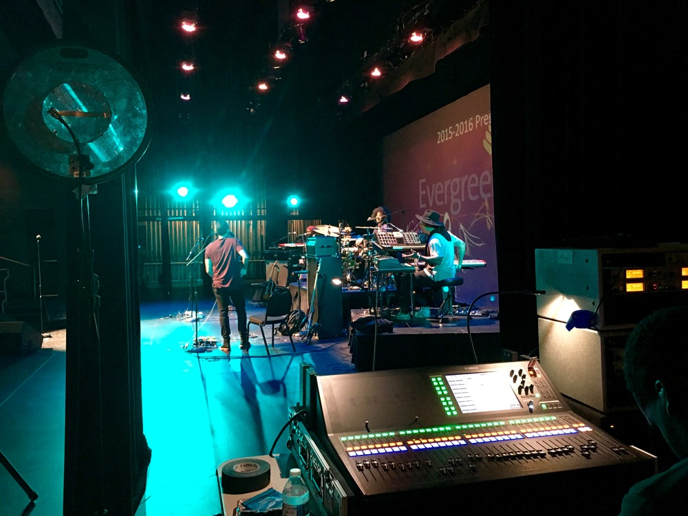 The band warms up backstage before the sold out show.
